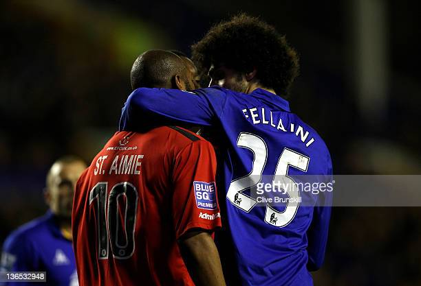Marouane Fellaini of Everton speaks to Keiron St Aimie of Tamworth following an altercation in the box during the FA Cup Third Round match between...