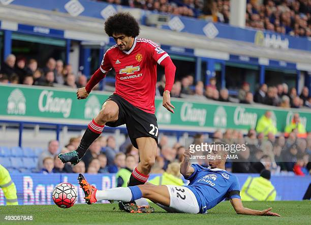 Marouane Fellaini of Manchester United and Brendan Galloway of Everton during the Barclays Premier League match between Everton and Manchester United...