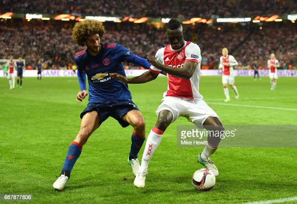 Marouane Fellaini of Manchester United and Davinson Sanchez of Ajax compete for the ball during the UEFA Europa League Final between Ajax and...