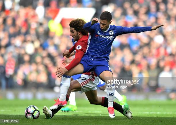 Marouane Fellaini of Manchester United and Eden Hazard of Chelsea battle for possession during the Premier League match between Manchester United and...