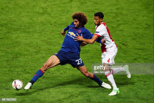 Marouane Fellaini of Manchester United and Jairo Riedewald of Ajax battle for possession during the UEFA Europa League Final between Ajax and...