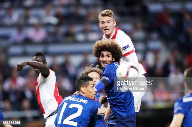 Marouane Fellaini of Manchester United and Kasper Dolberg of Ajax competes for the ball during the UEFA Europa League Final between Ajax and...
