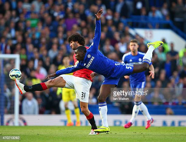 Marouane Fellaini of Manchester United and Kurt Zouma of Chelsea battle for the ball during the Barclays Premier League match between Chelsea and...
