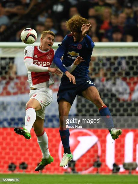 Marouane Fellaini of Manchester United and Matthijs de Ligt of Ajax compete for the ball during the UEFA Europa League final match between Ajax and...