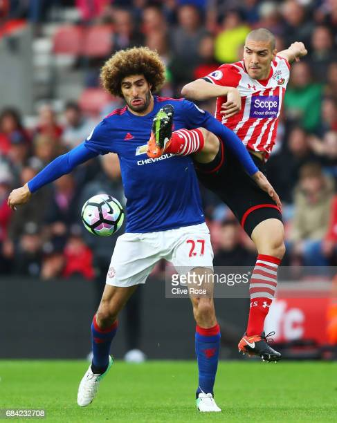 Marouane Fellaini of Manchester United and Oriol Romeu of Southampton battle for possession during the Premier League match between Southampton and...
