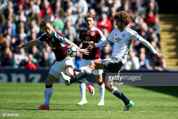 Marouane Fellaini of Manchester United battles for the ball with Ashley Barnes of Burnley during the Premier League match between Burnley and...