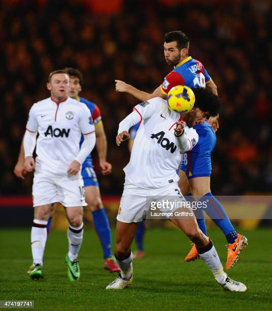 Marouane Fellaini of Manchester United battles with Joe Ledley of Crystal Palace during the Barclays Premier League match between Crystal Palace and...