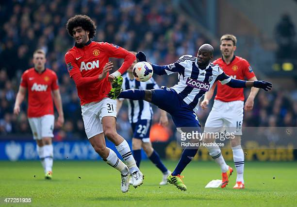Marouane Fellaini of Manchester United battles with Youssuf Mulumbu of West Bromwich Albion during the Barclays Premier League match between West...