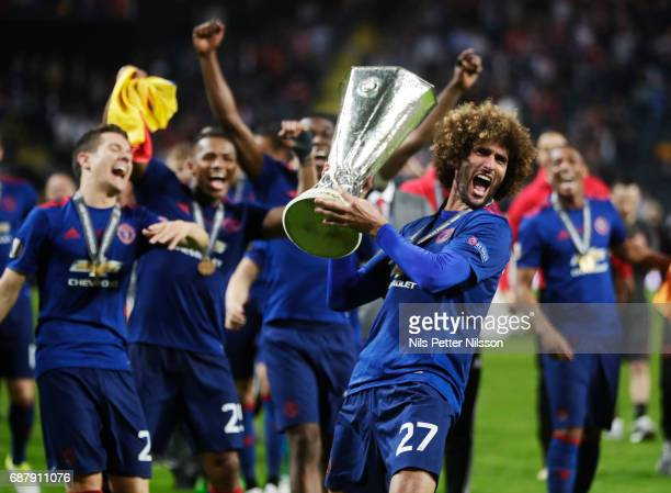 Marouane Fellaini of Manchester United celebrates after the victory with the trophy during the UEFA Europa League Final between Ajax and Manchester...