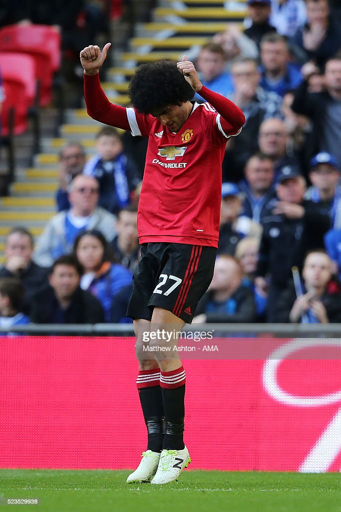 Marouane Fellaini of Manchester United celebrates scoring a goal to make the score 01 during the Emirates FA Cup Semi Final match between Everton and...