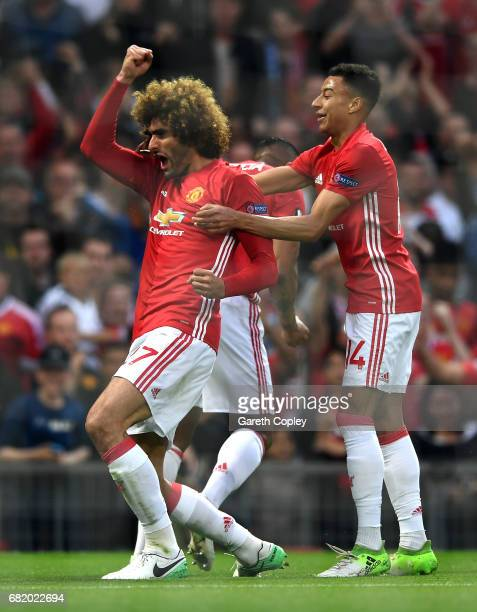 Marouane Fellaini of Manchester United celebrates scoring his sides first goal with team mates during the UEFA Europa League semi final second leg...