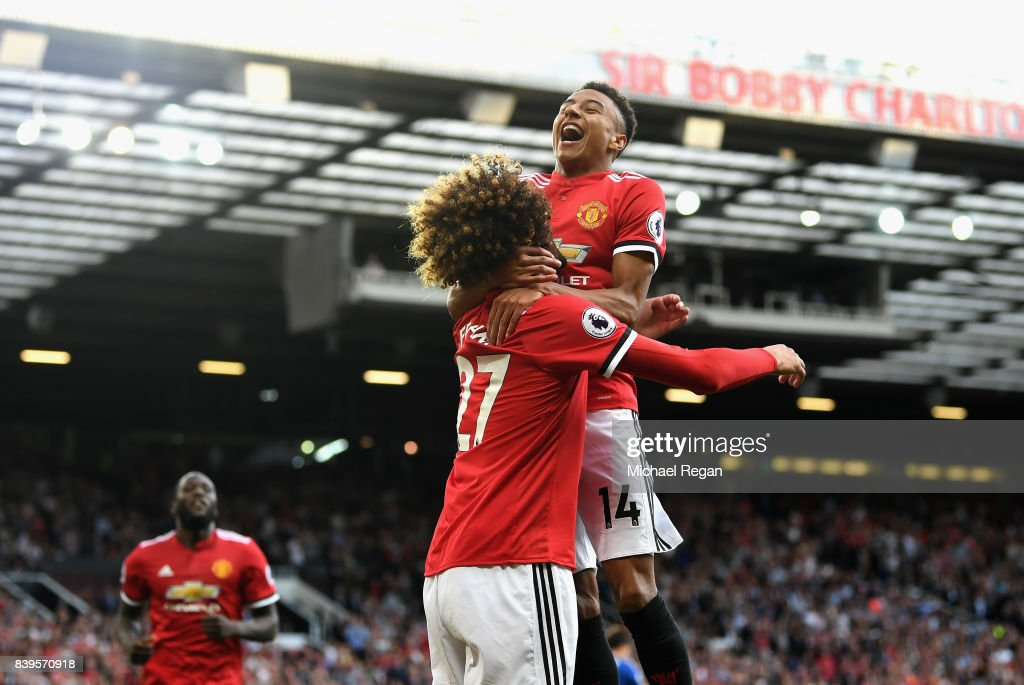 Marouane Fellaini of Manchester United celebrates scoring his sides second goal with Jesse Lingard of Manchester United during the Premier League match between Manchester United and Leicester City at Old Trafford on August 26, 2017 in Manchester, England.