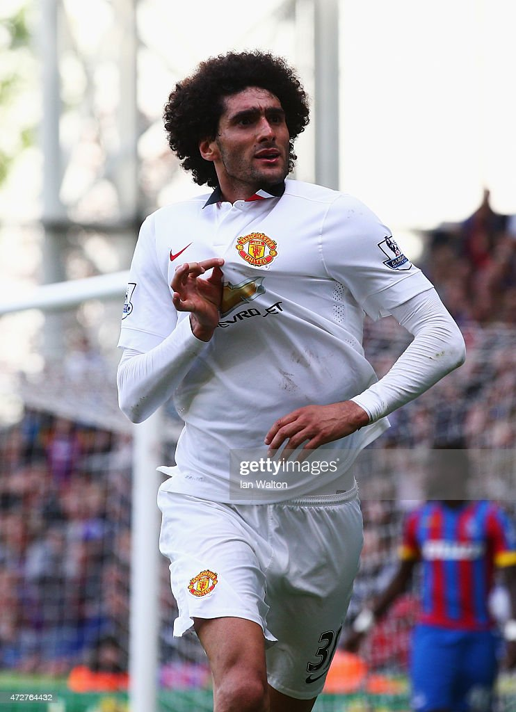 Marouane Fellaini of Manchester United celebrates scoring his team's second goal during the Barclays Premier League match between Crystal Palace and...
