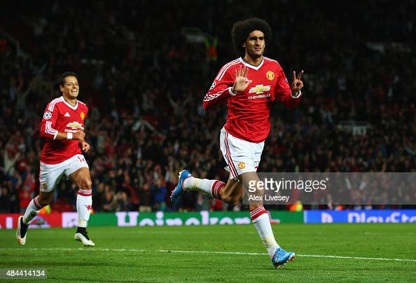 Marouane Fellaini of Manchester United celebrates scoring his team's third goal during the UEFA Champions League Qualifying Round Play Off First Leg...