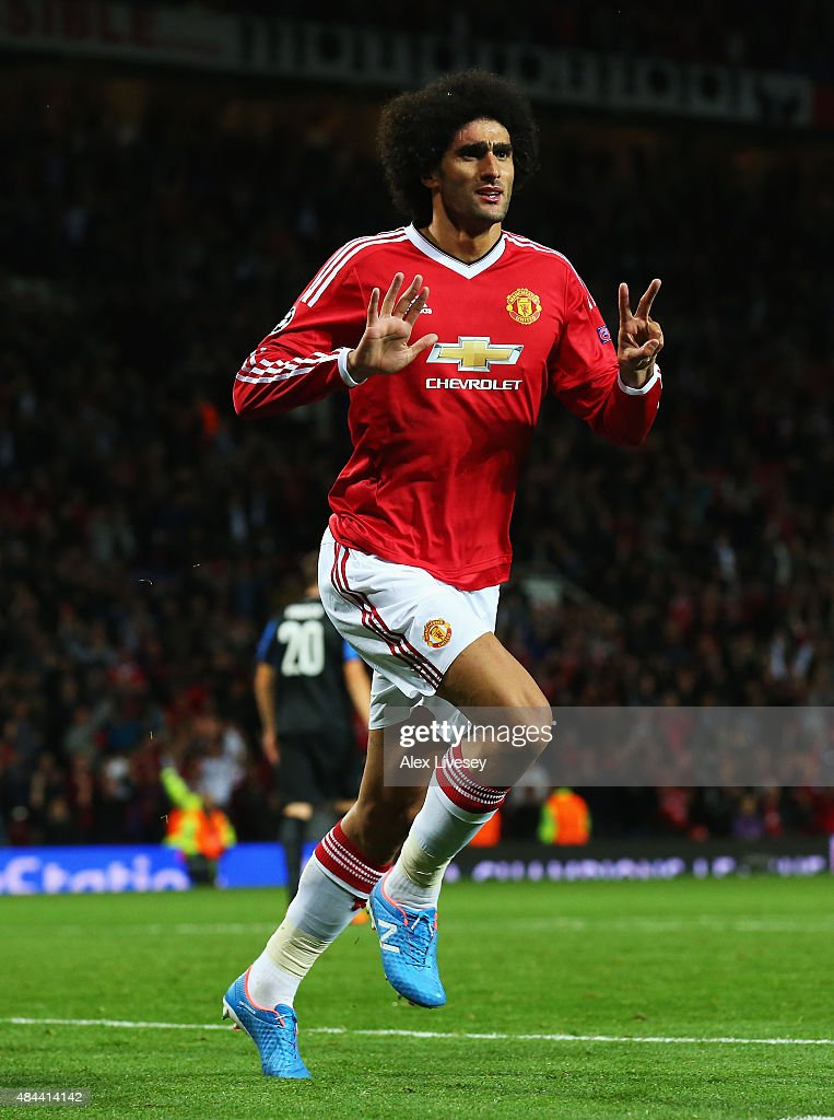 <a gi-track='captionPersonalityLinkClicked' href=/galleries/search?phrase=Marouane+Fellaini&family=editorial&specificpeople=3936316 ng-click='$event.stopPropagation()'>Marouane Fellaini</a> of Manchester United celebrates scoring his team's third goal during the UEFA Champions League Qualifying Round Play Off First Leg match between Manchester United and Club Brugge at Old Trafford on August 18, 2015 in Manchester, England.