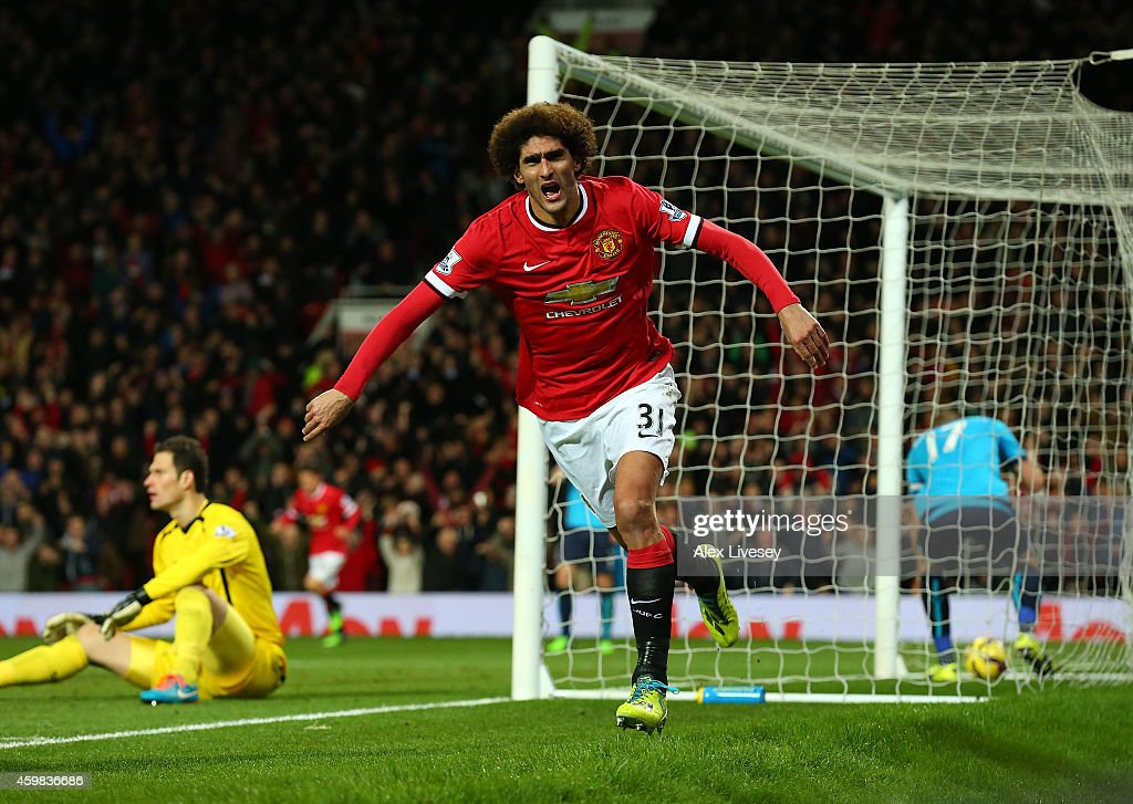<a gi-track='captionPersonalityLinkClicked' href=/galleries/search?phrase=Marouane+Fellaini&family=editorial&specificpeople=3936316 ng-click='$event.stopPropagation()'>Marouane Fellaini</a> of Manchester United celebrates scoring the first goal during the Barclays Premier League match between Manchester United and Stoke City at Old Trafford on December 2, 2014 in Manchester, England.