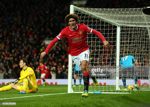 Marouane Fellaini of Manchester United celebrates scoring the first goal during the Barclays Premier League match between Manchester United and Stoke...