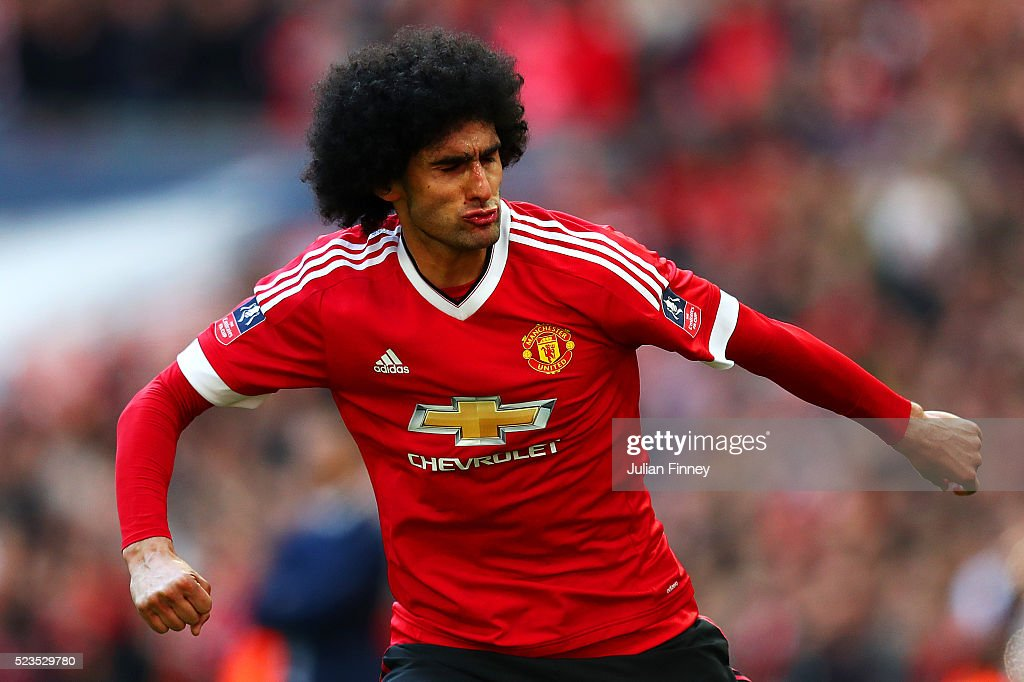 <a gi-track='captionPersonalityLinkClicked' href=/galleries/search?phrase=Marouane+Fellaini&family=editorial&specificpeople=3936316 ng-click='$event.stopPropagation()'>Marouane Fellaini</a> of Manchester United celebrates scoring the opening goal during The Emirates FA Cup semi final match between Everton and Manchester United at Wembley Stadium on April 23, 2016 in London, England.