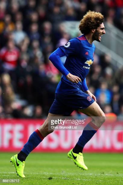 Marouane Fellaini of Manchester United celebrates scoring the opening goal during the Premier League match between Middlesbrough and Manchester...