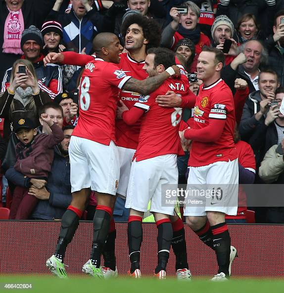 Marouane Fellaini of Manchester United celebrates scoring their first goal during the Barclays Premier League match between Manchester United and...