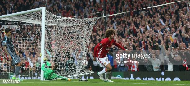 Marouane Fellaini of Manchester United celebrates scoring their first goal during the UEFA Europa League semi final second leg match between...
