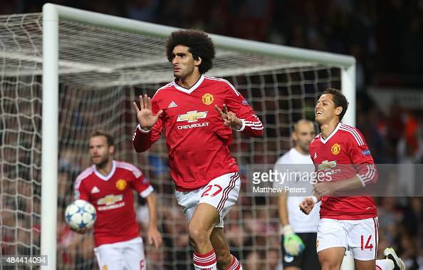 Marouane Fellaini of Manchester United celebrates scoring their third goal during the UEFA Champions League playoff first leg match between...