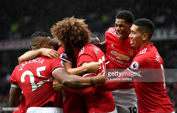 Marouane Fellaini of Manchester United celebrates scroing his side's third goal with his team mates during the Premier League match between...