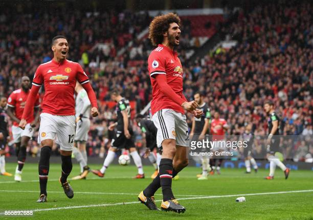Marouane Fellaini of Manchester United celebrates scroing his side's third goal during the Premier League match between Manchester United and Crystal...
