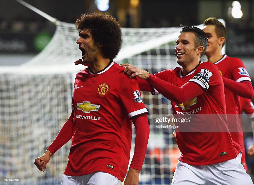 Marouane Fellaini of Manchester United celebrates with Robin van Persie and Adnan Januzaj as he scores their first and equalising goal during the...