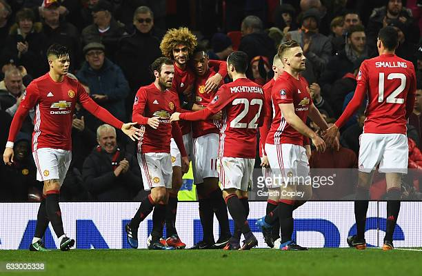 Marouane Fellaini of Manchester United celerbates with team mates as he scores their first goal during the Emirates FA Cup Fourth round match between...