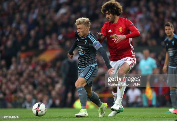 Marouane Fellaini of Manchester United challenges Daniel Wass of Celta Vigo during the UEFA Europa League semi final second leg match between...