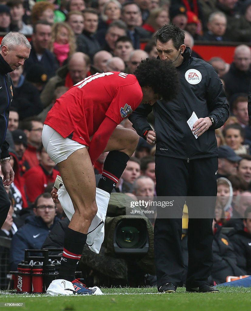 Marouane Fellaini of Manchester United changes his shorts during the Barclays Premier League match between Manchester United and Liverpool at Old...