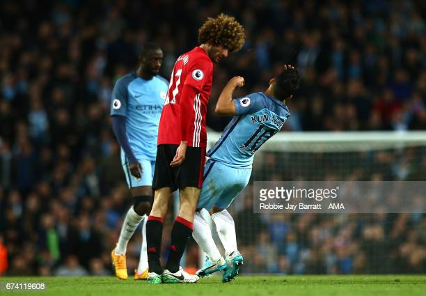 Marouane Fellaini of Manchester United clashes heads with Sergio Aguero of Manchester City during the Premier League match between Manchester City...