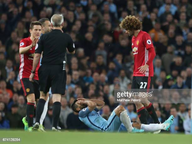 Marouane Fellaini of Manchester United clashes with Sergio Aguero of Manchester City during the Premier League match between Manchester City and...