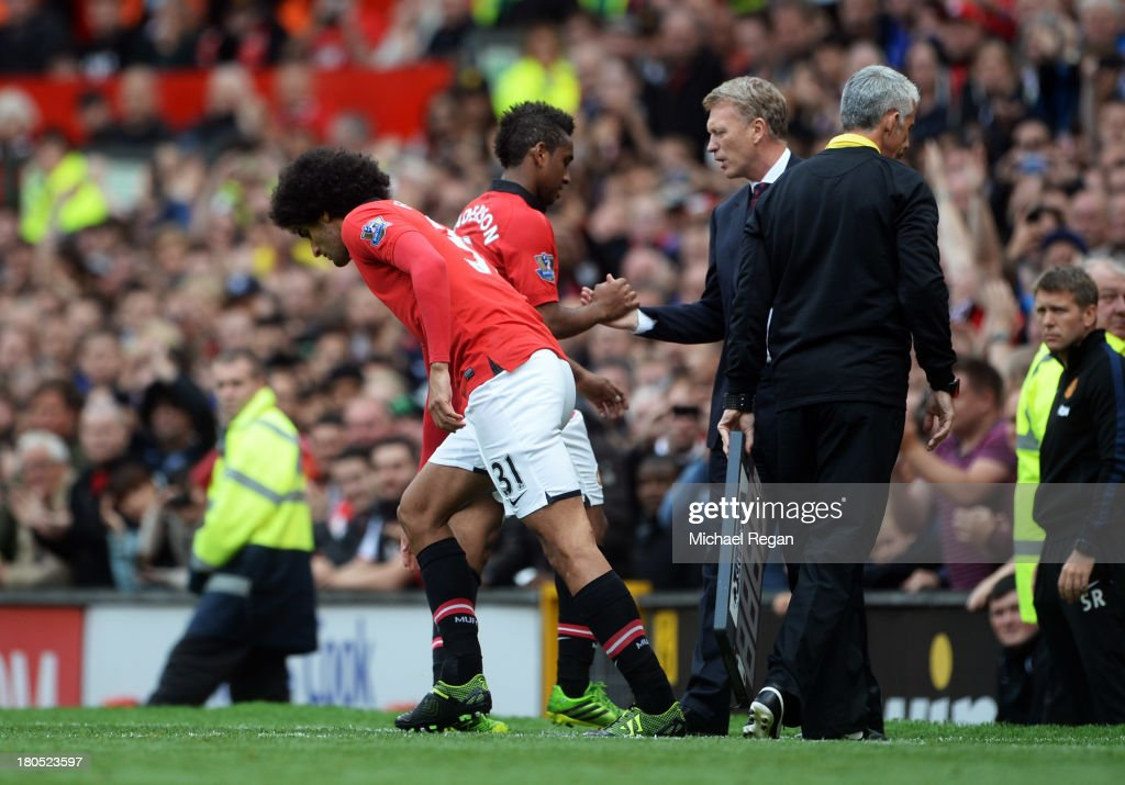 Marouane Fellaini of Manchester United comes on for team mate Anderson to make his debut watched by manager David Moyes during the Barclays Premier League match between Manchester United and Crystal Palace at Old Trafford on September 14, 2013 in Manchester, England.