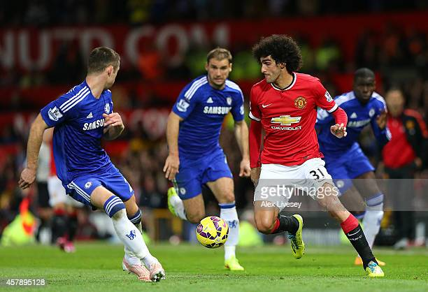 Marouane Fellaini of Manchester United competes with Gary Cahill of Chelsea during the Barclays Premier League match between Manchester United and...