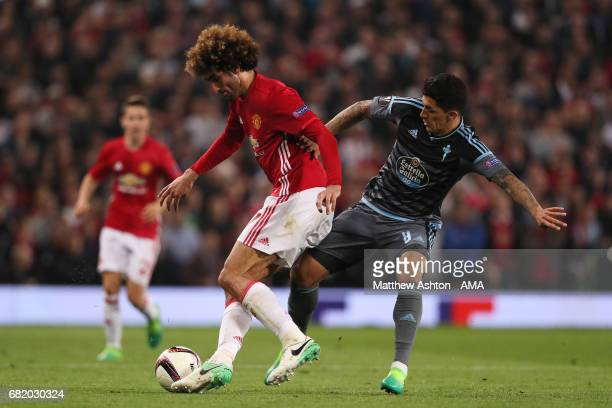 Marouane Fellaini of Manchester United competes with Pablo Hernandez of Celta Vigo during the UEFA Europa League semi final second leg match between...