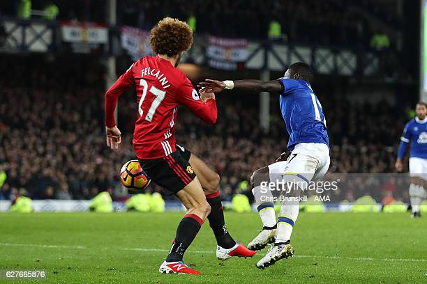 Marouane Fellaini of Manchester United fouls Idrissa Gueye of Everton in the penalty box during the Premier League match between Everton and...