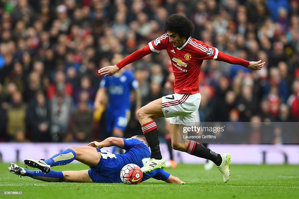 <a gi-track='captionPersonalityLinkClicked' href=/galleries/search?phrase=Marouane+Fellaini&family=editorial&specificpeople=3936316 ng-click='$event.stopPropagation()'>Marouane Fellaini</a> of Manchester United goes past <a gi-track='captionPersonalityLinkClicked' href=/galleries/search?phrase=Danny+Drinkwater&family=editorial&specificpeople=4224396 ng-click='$event.stopPropagation()'>Danny Drinkwater</a> of Leicester City during the Barclays Premier League match between Manchester United and Leicester City at Old Trafford on May 1, 2016 in Manchester, England.