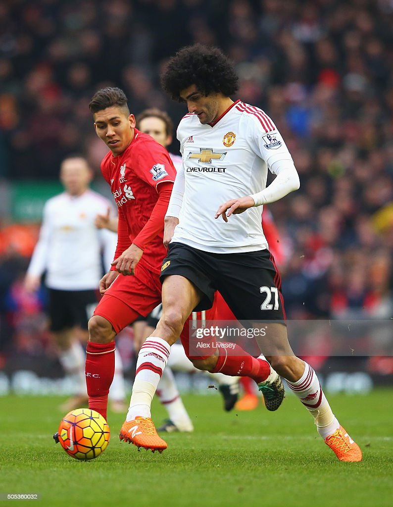 Marouane Fellaini of Manchester United goes past Roberto Firmino of Liverpool during the Barclays Premier League match between Liverpool and...
