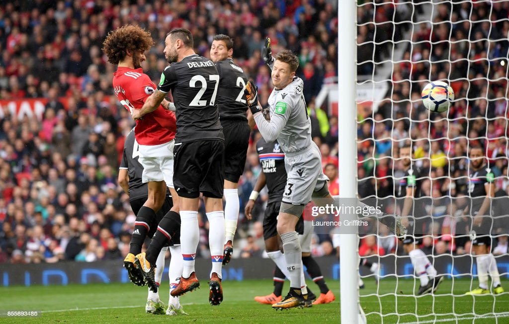Marouane Fellaini of Manchester United heads the ball to score his side's third goal during the Premier League match between Manchester United and Crystal Palace at Old Trafford on September 30, 2017 in Manchester, England.