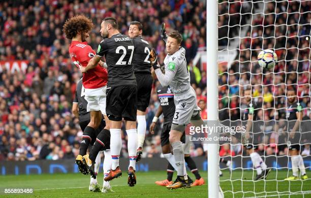 Marouane Fellaini of Manchester United heads the ball to score his side's third goal during the Premier League match between Manchester United and...