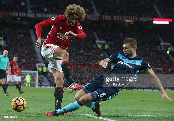Marouane Fellaini of Manchester United in action with Ben Gibson of Middlesbrough during the Premier League match between Manchester United and...