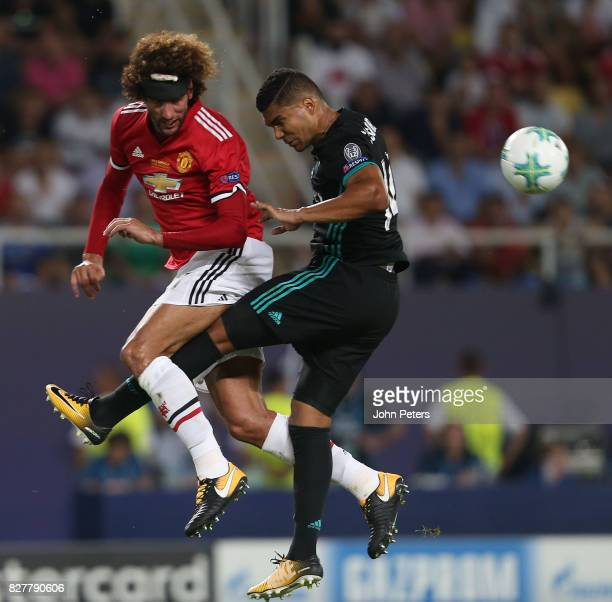 Marouane Fellaini of Manchester United in action with Casemiro of Real Madrid during the UEFA Super Cup match between Real Madrid and Manchester...