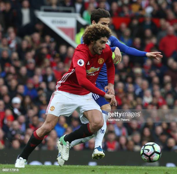 Marouane Fellaini of Manchester United in action with Cesc Fabregas of Chelsea during the Premier League match between Manchester United and Chelsea...