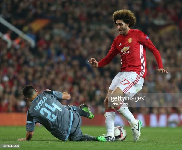 Marouane Fellaini of Manchester United in action with Facundo Roncaglia of Celta Vigo during the UEFA Europa League semi final second leg match...