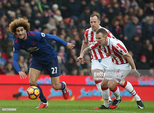 Marouane Fellaini of Manchester United in action with Glenn Whelan of Stoke City during the Premier League match between Stoke City and Manchester...