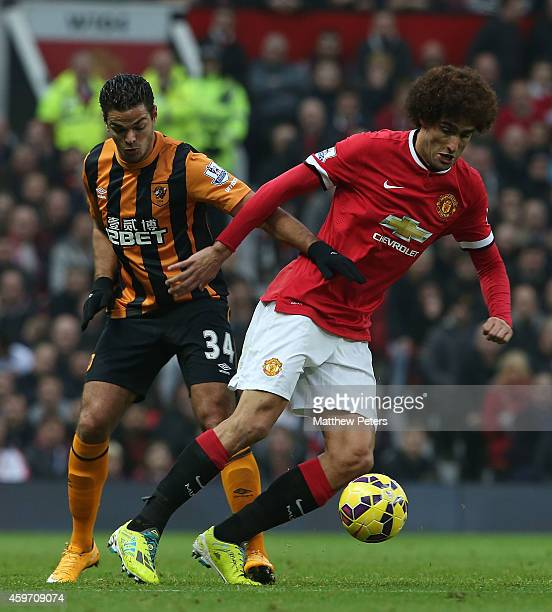 Marouane Fellaini of Manchester United in action with Hatem Ben Arfa of Hull City during the Barclays Premier League match between Manchester United...