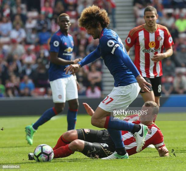 Marouane Fellaini of Manchester United in action with Lee Cattermole of Sunderland during the Premier League match between Sunderland and Manchester...