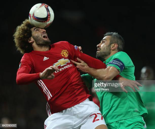 Marouane Fellaini of Manchester United in action with Loic Perrin of AS SaintEtienne during the UEFA Europa League Round of 32 first leg match...
